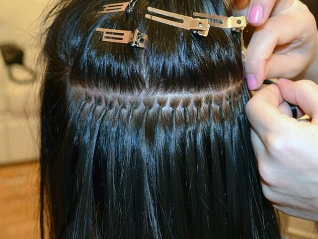 Итальянское наращивание волос темного цвета